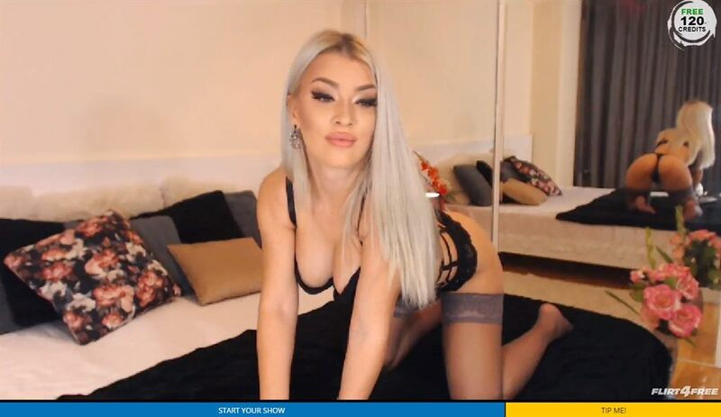 Blonde big breasted cam model in sexy lingerie