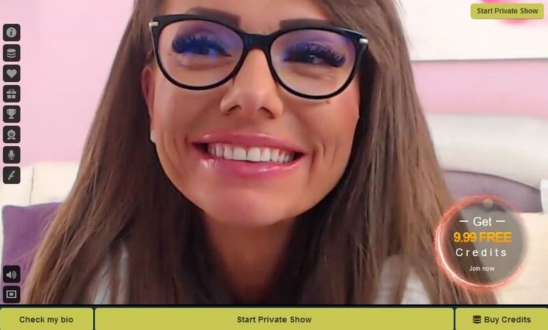 A sexy cam babe wears black framed glasses on LivePrivates.com