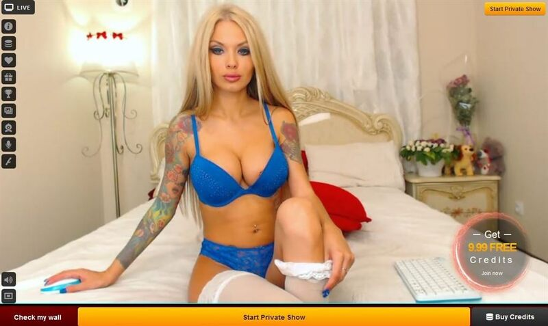 A tattooed glamour cam model on LiveJasmin