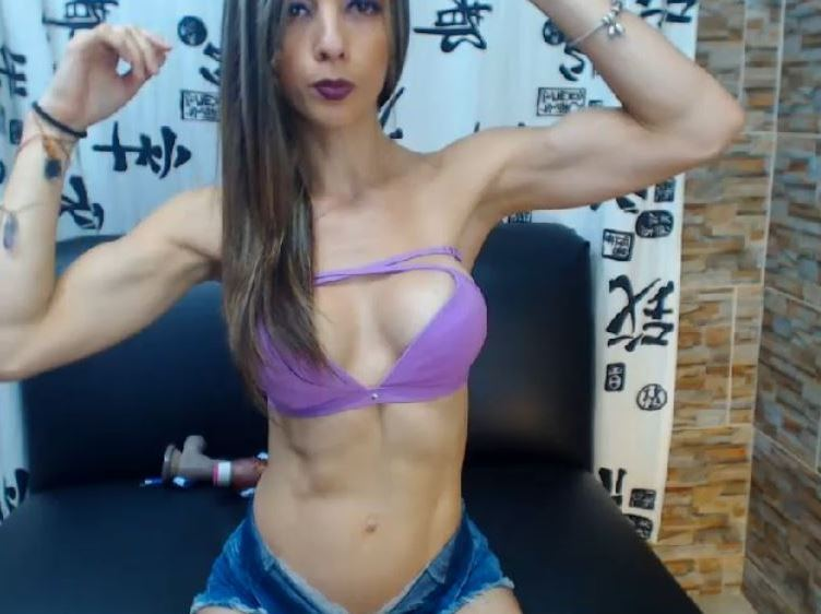 Toned cam girl on MyFreecams flexing her biceps