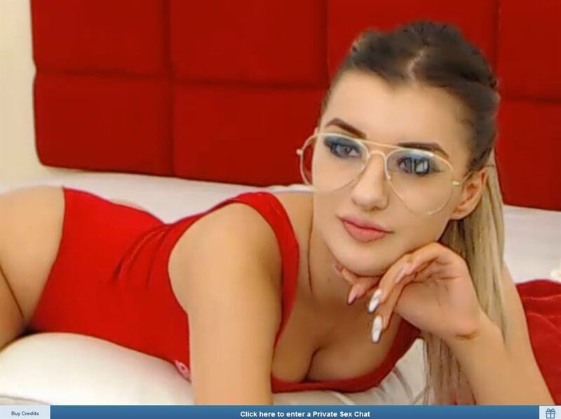 Sexy webcam model in a red swimsuit